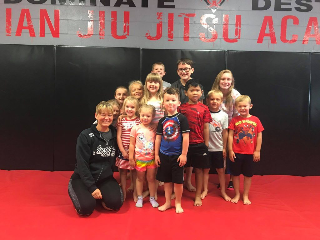 Purple Belt World Champion in Brazilian Jiu-Jitsu teaches kids class in Greenwood Indiana.