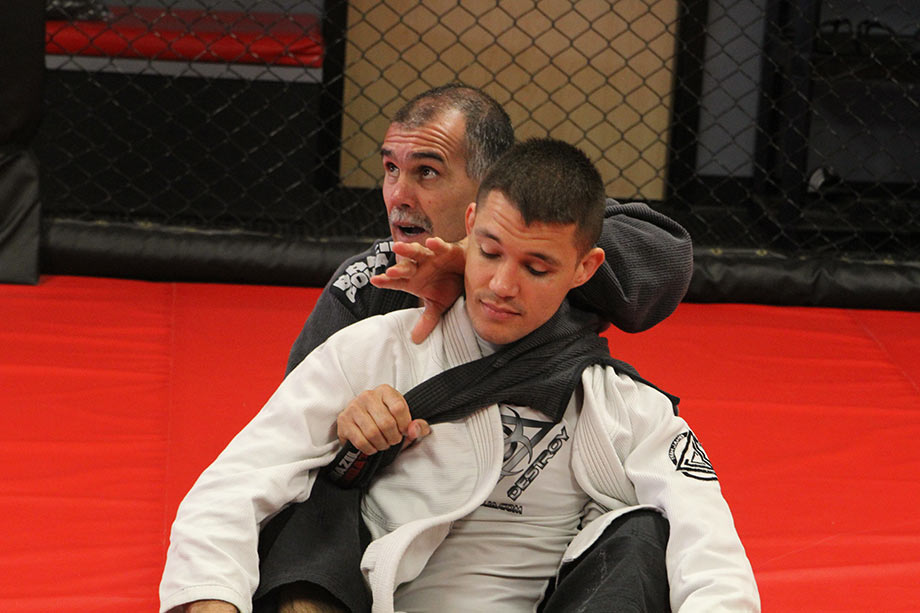 Coral Belt Anibal Braga demonstrates a Brazilian Jiu-Jitsu technique in an IBJJA seminar.