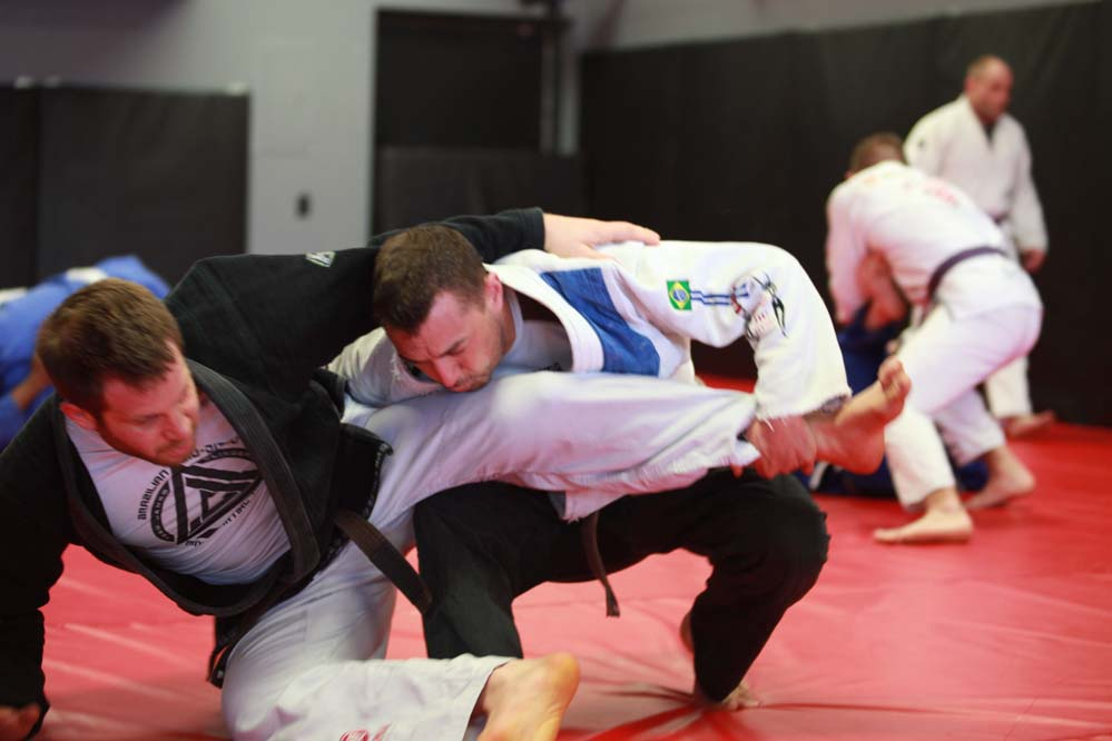 Photo of two Indiana Brazilian Jiu-Jitsu instructors sparring in class.