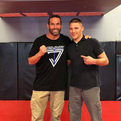 Indiana Brazilian Jiu-Jitsu Academy Coach James Clingerman with Royce Gracie Black Belt Jonathan Burke.