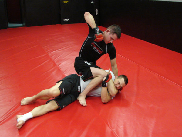 Coach James Clingerman demonstrating the gift-wrap position in Mixed Martial Arts