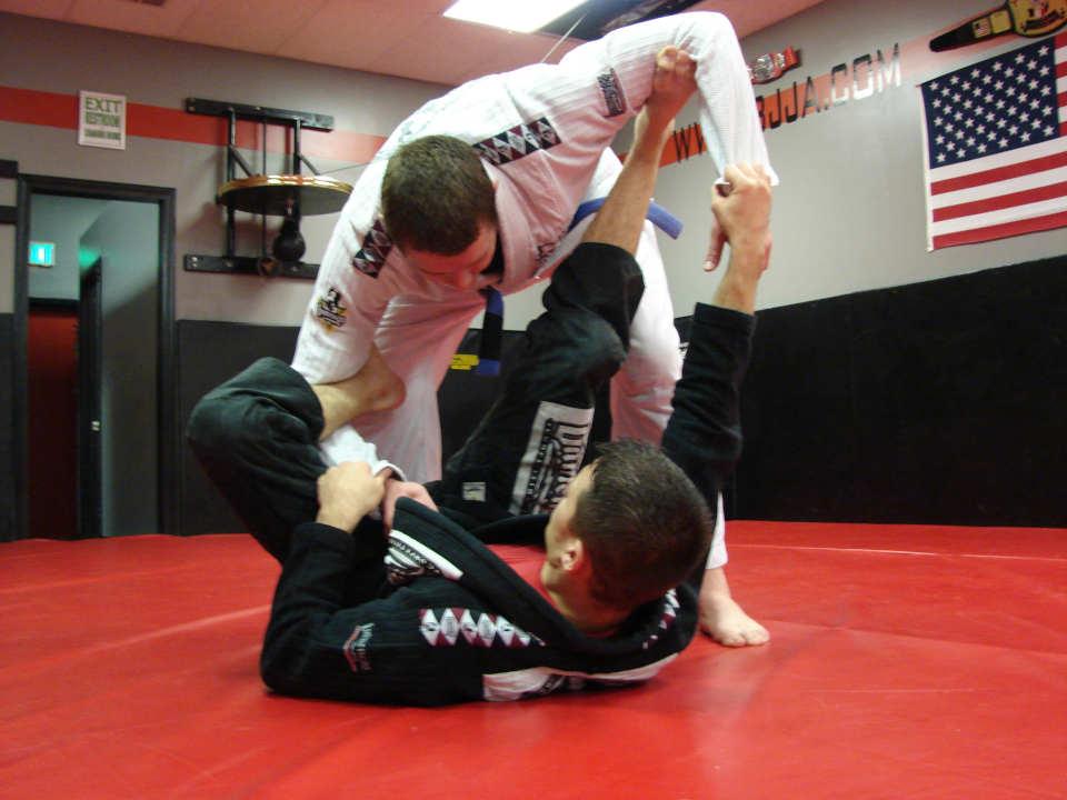 Photo of Coach James Clingerman demonstrating the Brazilian Jiu-Jitsu spider guard