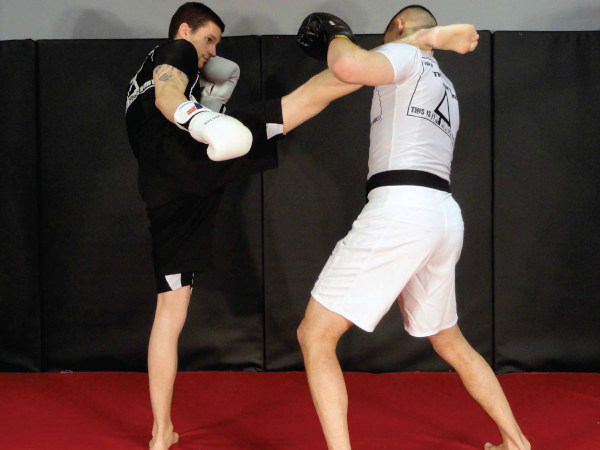 Photo of coach Chris demonstrating a head kick at Indiana Brazilian Jiu-Jitsu Academy