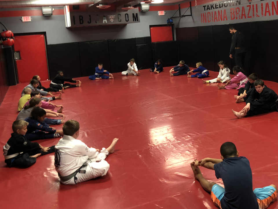 Photo of kids stretching in Brazilian Jiu-Jitsu class at Indiana Brazilian Jiu-Jitsu Academy