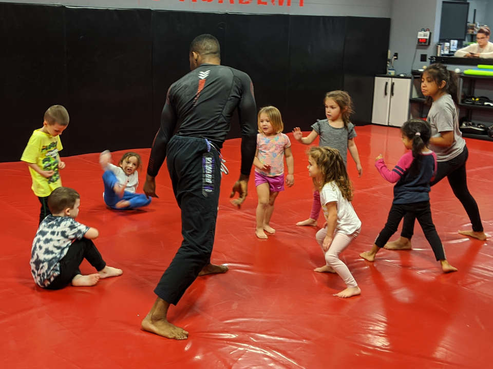 Photo of Emanuel Carey teaching kids' Brazilian Jiu-Jitsu class at Indiana Brazilian Jiu-Jitsu Academy