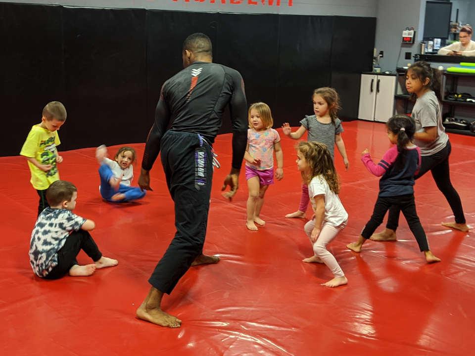 Photo of Emanuel Carey teaching kids' Brazilian Jiu-Jitsu class at Indiana Brazilian Jiu-Jitsu Academy