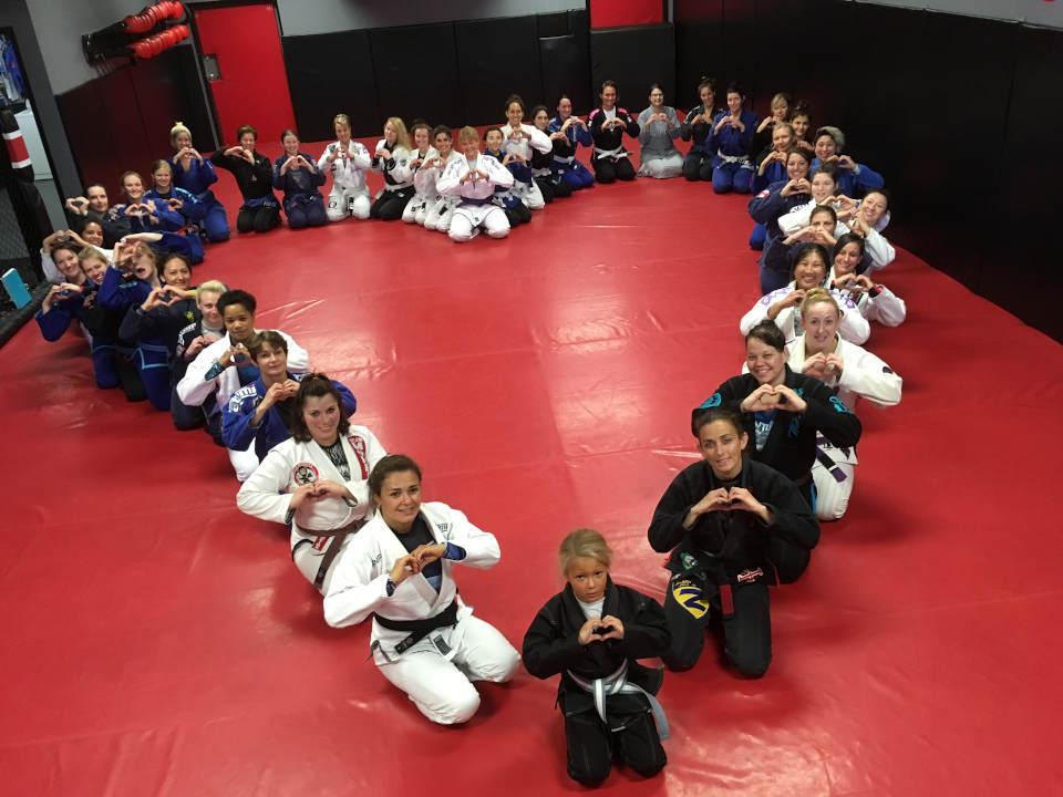 Photo of women arranged in the shape of a heart at Indiana Brazilian Jiu-Jitsu Academy