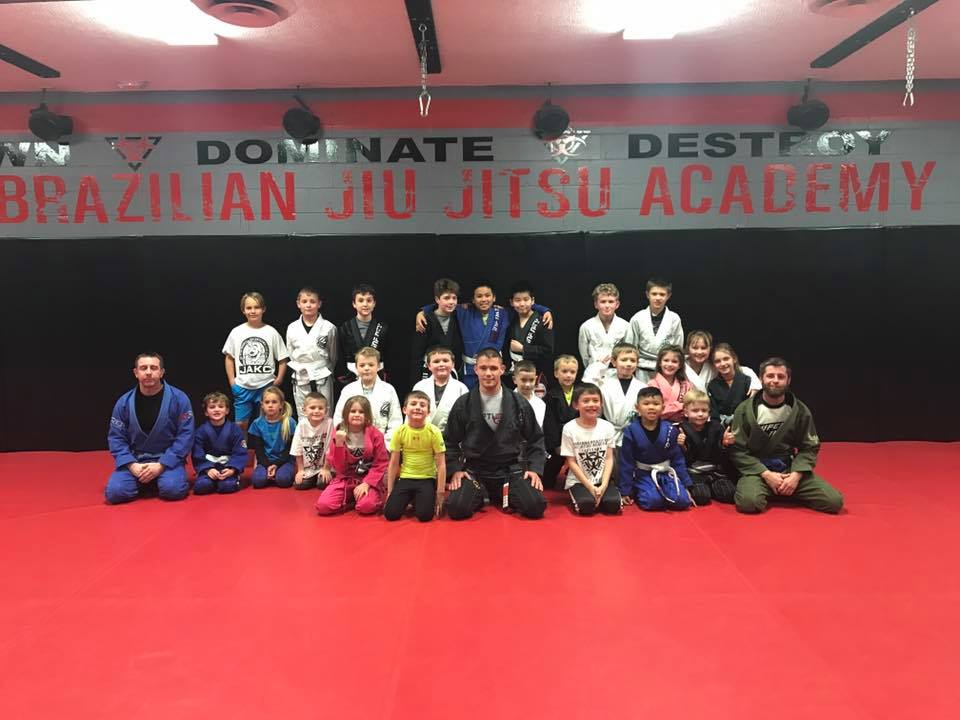 Photo of James Clingerman with the kids of Indiana Brazilian Jiu-Jitsu Academy