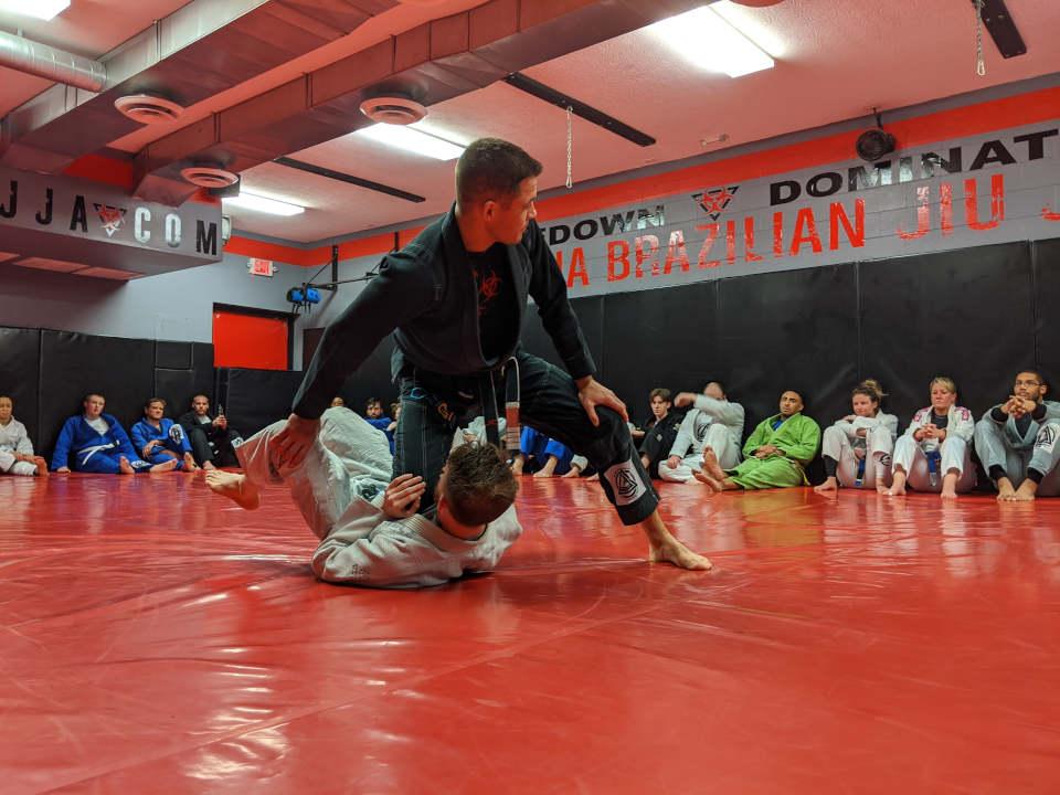 Photo of Coach James Clingerman teaching Brazilian Jiu-Jitsu at IBJJA